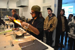 Jamie Hughes blowing glass